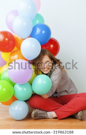 Woman Hugging Balloons - stock photo