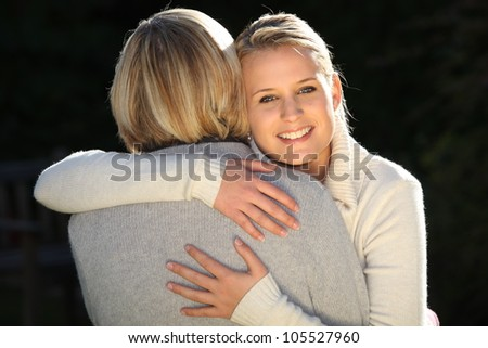 Woman hugging her mother - stock photo