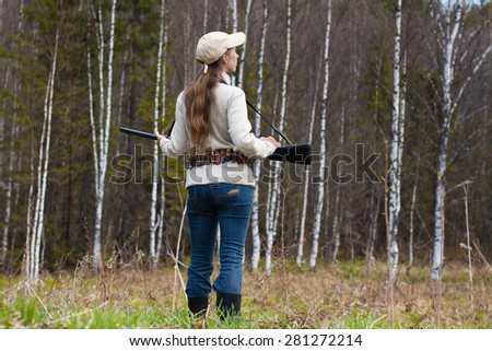 Woman hunter on the forest edge - stock photo