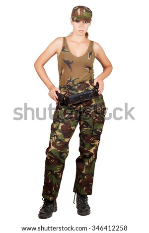 Woman hunter with a cartridge belt, standing with hands on hips. Isolated on white background - stock photo