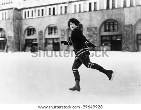 Woman ice skating outside - stock photo