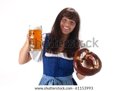 woman in a bavarian dress with beer and pretzel