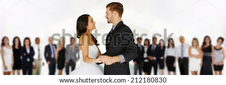 Woman in a beautiful white wedding dress with groom - stock photo