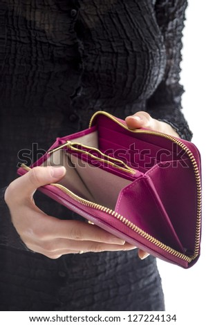 Woman in a black dress holding an empty wallet. - stock photo