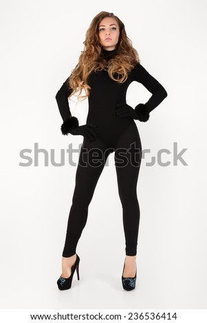 Woman in a black suit. Isolation on a white background in the studio.