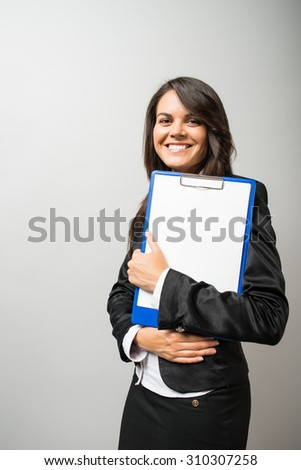 woman in a business suit with a folder - stock photo