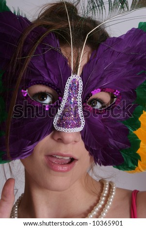 woman in a butterfly mask - stock photo