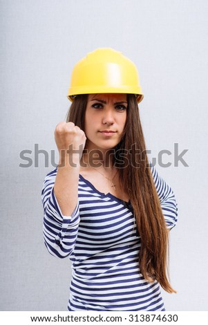 woman in a construction helmet