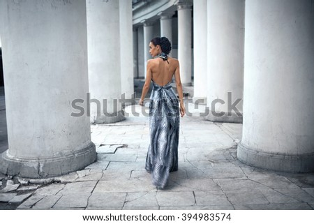 woman in a dress on a beautiful background - stock photo