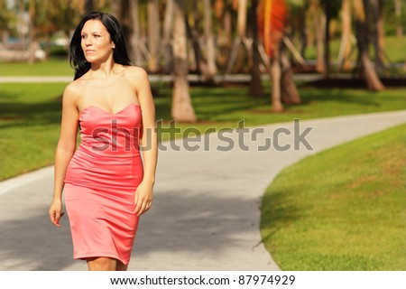 Woman in a dress walking in the park