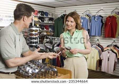 Woman in a Golf Shop - stock photo