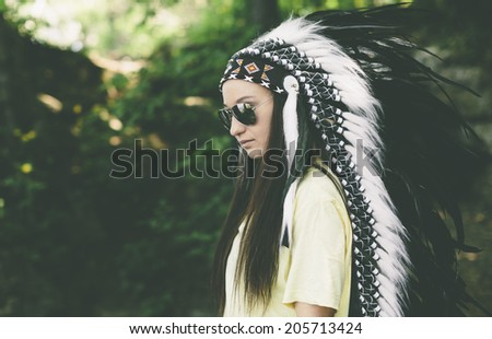 woman in a headdress on the nature background - stock photo