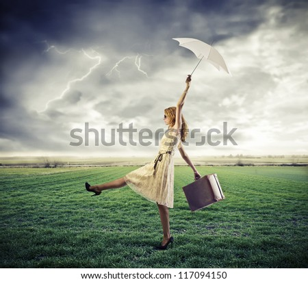 Woman, in a large grace field, is taken away by a gust