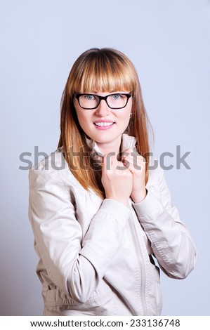 woman in a light jacket holds a collar - stock photo