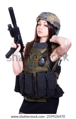 Woman in a military camouflage with a submachine gun isolated over white background - stock photo