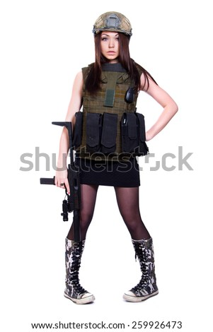 Woman in a military camouflage with a submachine gun isolated over white background