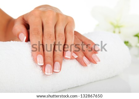 Woman in a nail salon receiving a manicure - stock photo