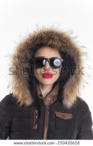 woman in a parka isolated on white  - stock photo