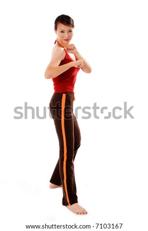 woman in a prepare state to defend during fitness exercise