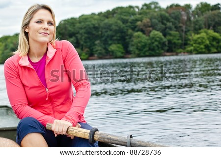 Woman in a rowboat on a lake