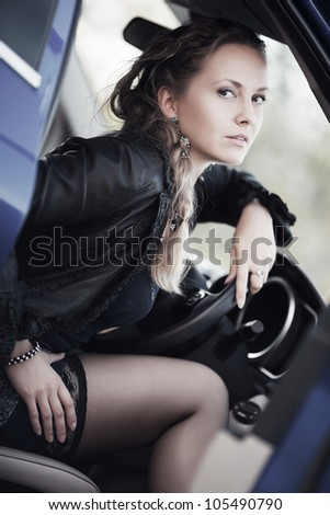 Woman in a sports car - stock photo
