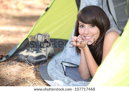 Woman in a tent - stock photo