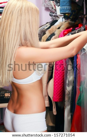 Woman in a wardrobe - stock photo
