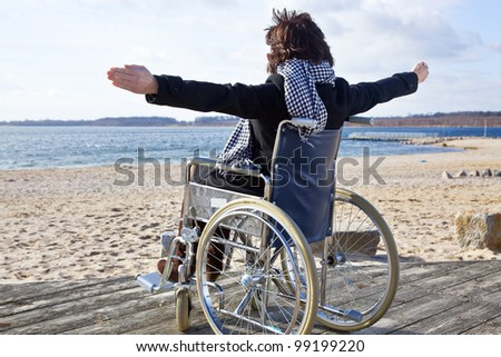 Woman in a wheelchair on the beach