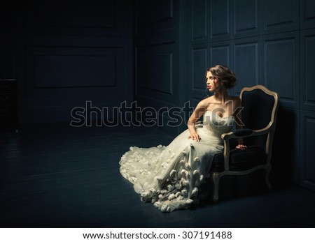 Woman in a white dress in studio - stock photo