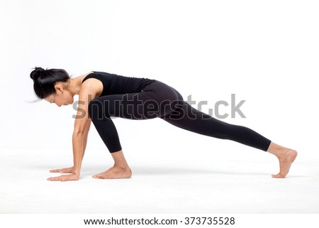 woman in a yoga pose in the studio - stock photo