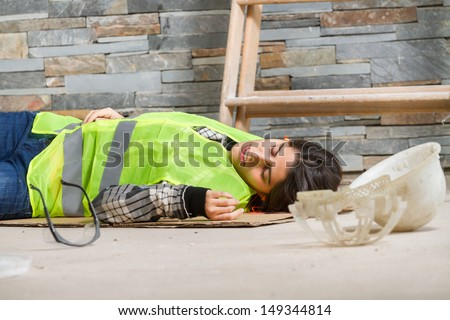 Woman in accident at workplace - stock photo