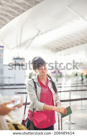 woman in airport - stock photo