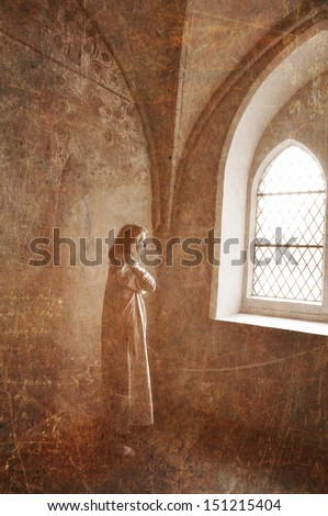 Woman in an abandoned building stare into vacancy. - stock photo