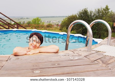 Woman in an outdoor pool