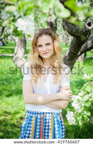 woman in apple tree bloom