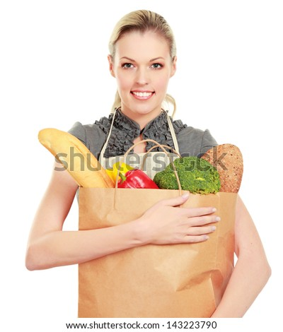 Woman in apron holding grocery bag, isolated on white background