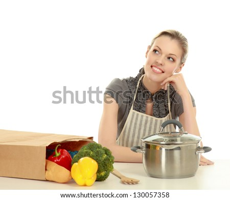 Woman in apron with grocery bag , isolated on white background - stock photo