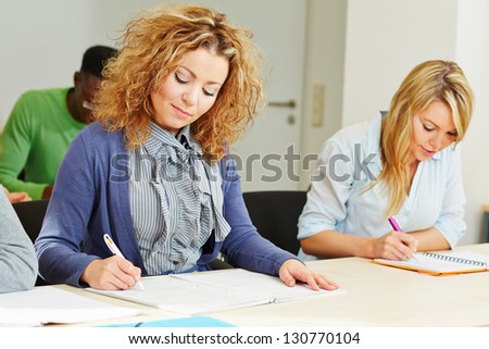 Woman in assessment center taking aptitude test for employee screening - stock photo