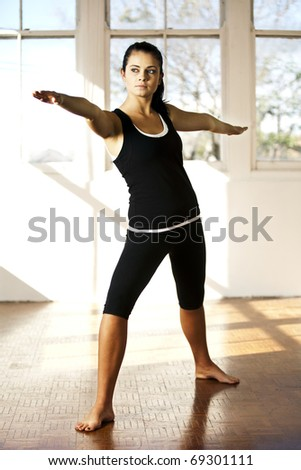 Woman in athletic attire doing yoga pose