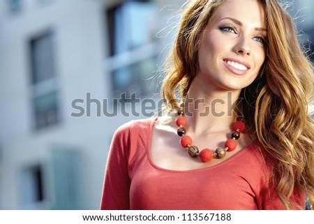 Woman in autumn  city - stock photo
