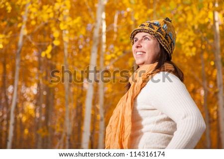 Woman in Autumn Forest of Aspen Trees - stock photo