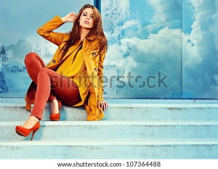 Woman in autumn Moscow city - stock photo