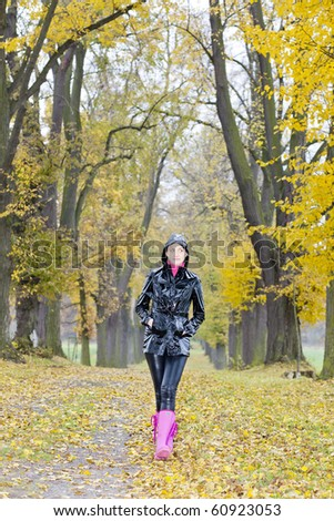 woman in autumnal alley - stock photo