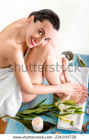 Woman in bath towels having rest sitting in spa salon. Enjoying spa procedures - stock photo