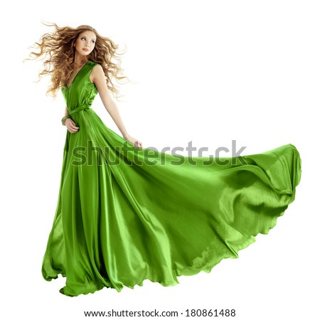 Woman in beauty fashion green gown, beautiful girl dancing in long evening dress over isolated white background  - stock photo