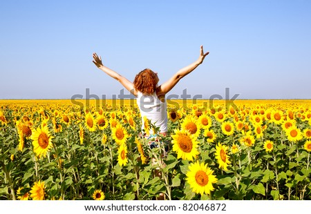 woman in beauty field with sunflowers
