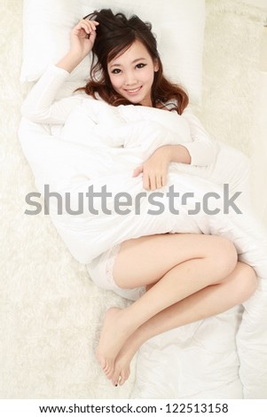 Woman in bed sleeping - stock photo