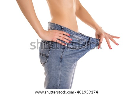 Woman in big jeans. Isolated on white background. - stock photo