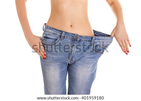 Woman in big jeans. Isolated on white background.
