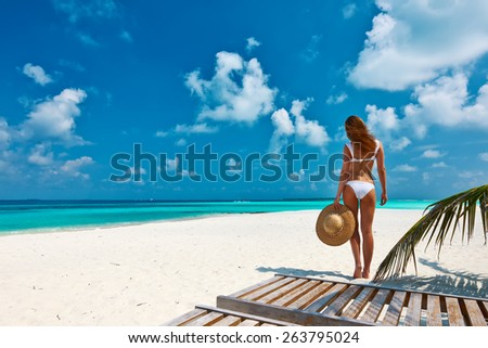 Woman in bikini on a tropical beach at Maldives - stock photo